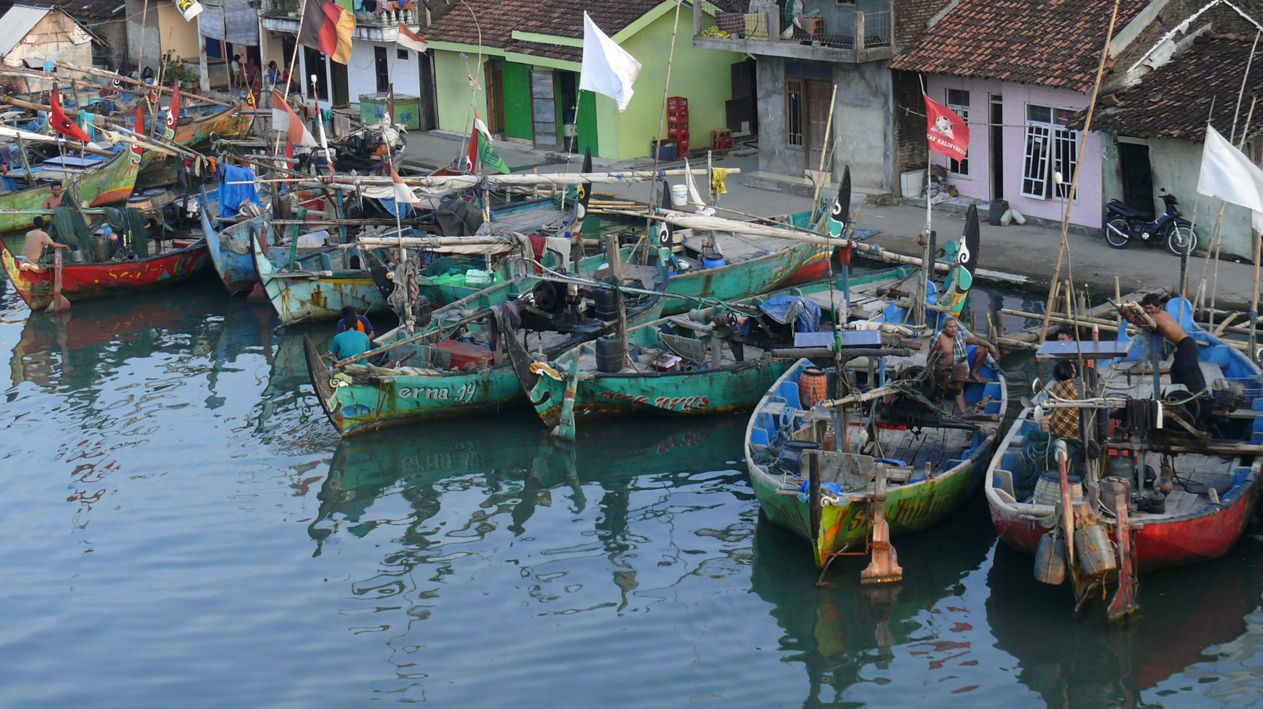 Boats moored in a fishing village