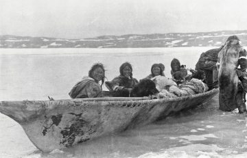 Copper Inuit people in umiak at Port Epworth, circa 1915. Creative Commons