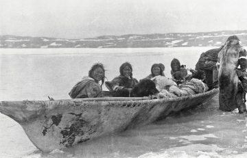 Copper Inuit people in umiak at Port Epworth, circa 1915. Creative Commons
