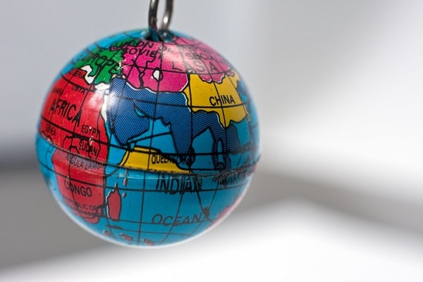 Old key chain in th shape of a small Earth Globe